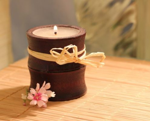 candle with pink flower
