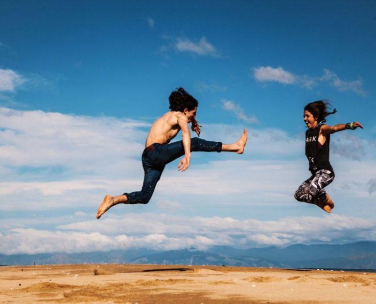 couple jumping in desert