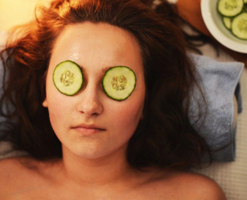 woman at spa cucumber eyes