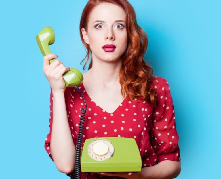 red head woman with telephone
