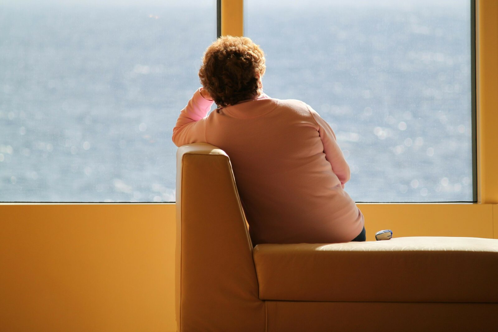 lonely lady sitting by window