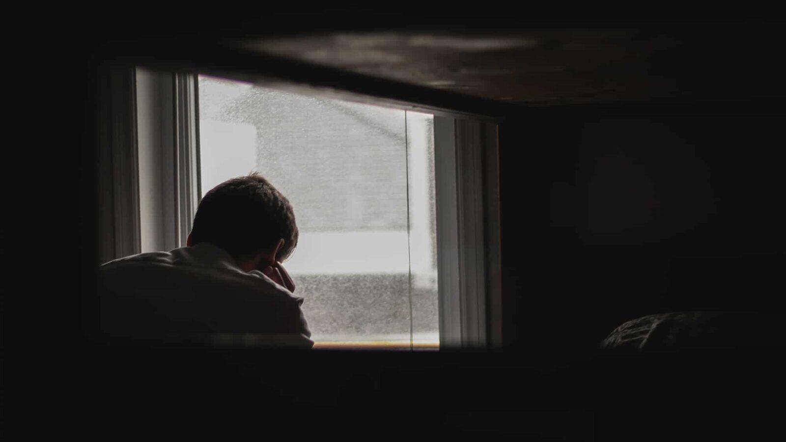 sad-man-in-dark-bedroom