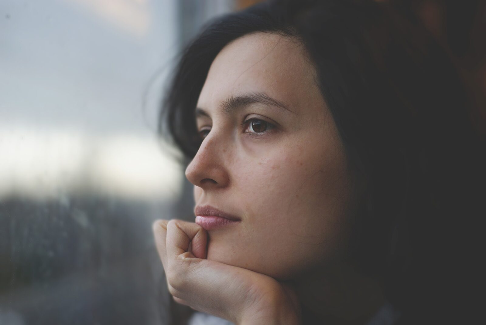 woman-staring-out-window-thinking