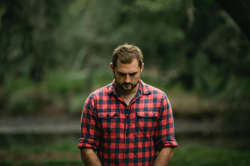 worried-man-plaid-shirt