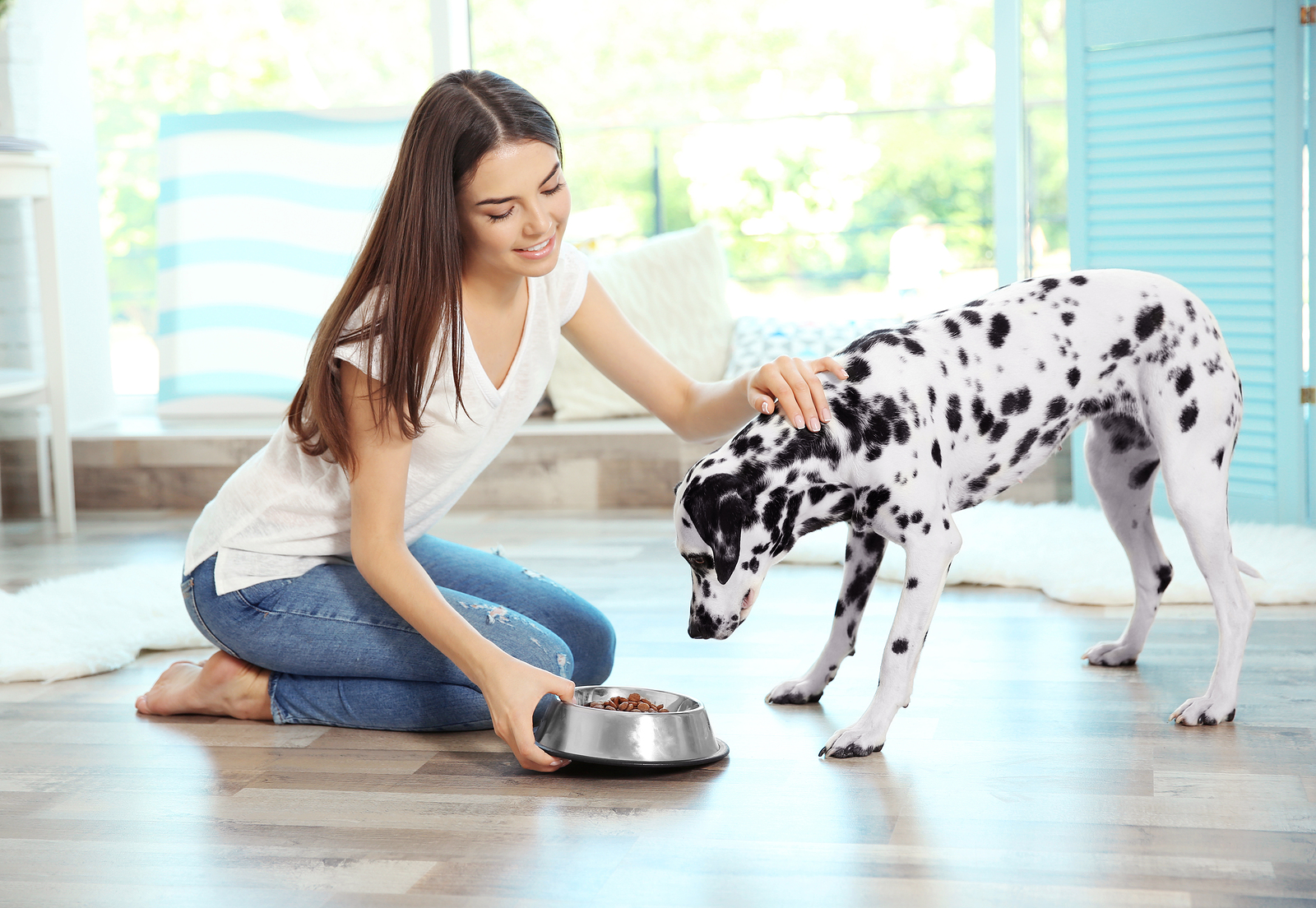 Woman feeding dog
