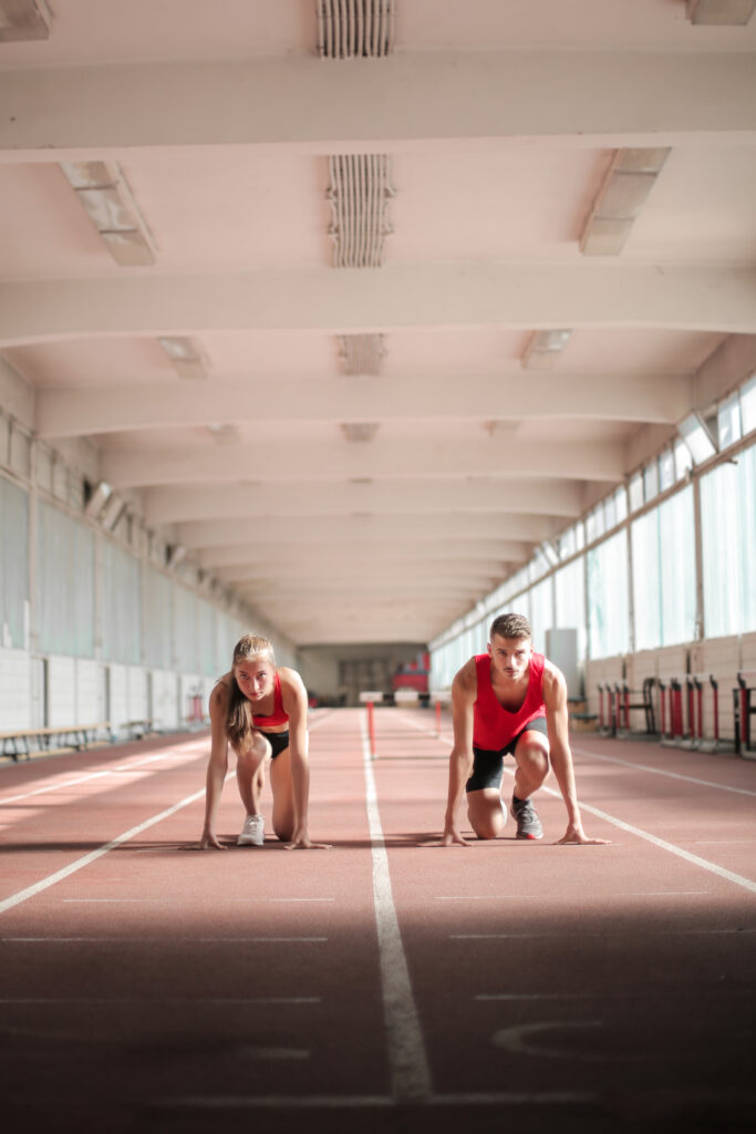 young-athletes-preparing-for-running-in-training-hall