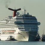 Carnival is laying off workers and cutting pay as COVID-19 freezes the cruise industry