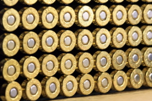 A row of 45 caliber ammunition copper plated bullets