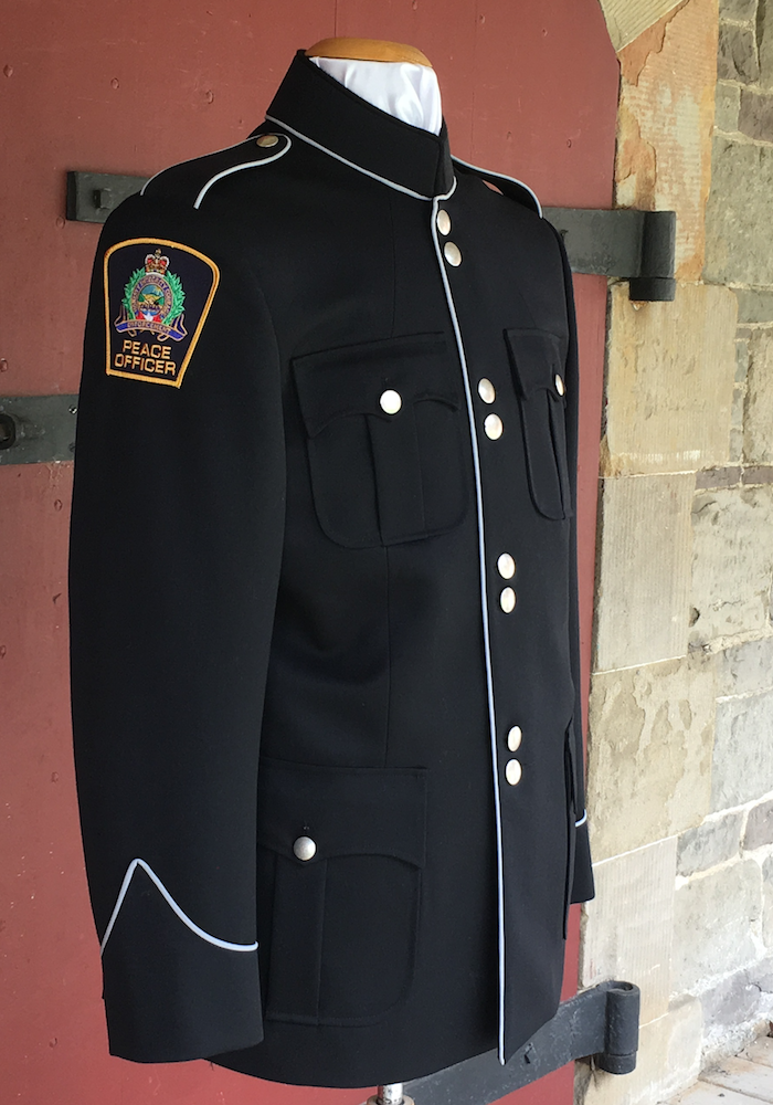 https://secureservercdn.net/166.62.107.20/741.240.myftpupload.com/wp-content/uploads/2018/08/Peace-Officer-Tunic.png?time=1591119416