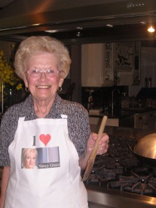 Bette wearing her Nancy Grace apron.  For years, she insisted that I looked like her.  I forgive you, Mom.