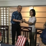 Ma Sa Nyein San accepting MEHS Foundation scholarship award from Dennis Tan