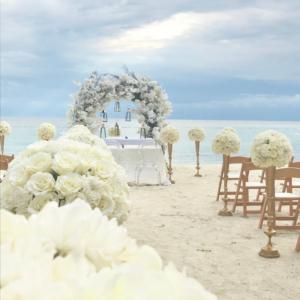 White flowers, sand, blue sky. Destination wedding