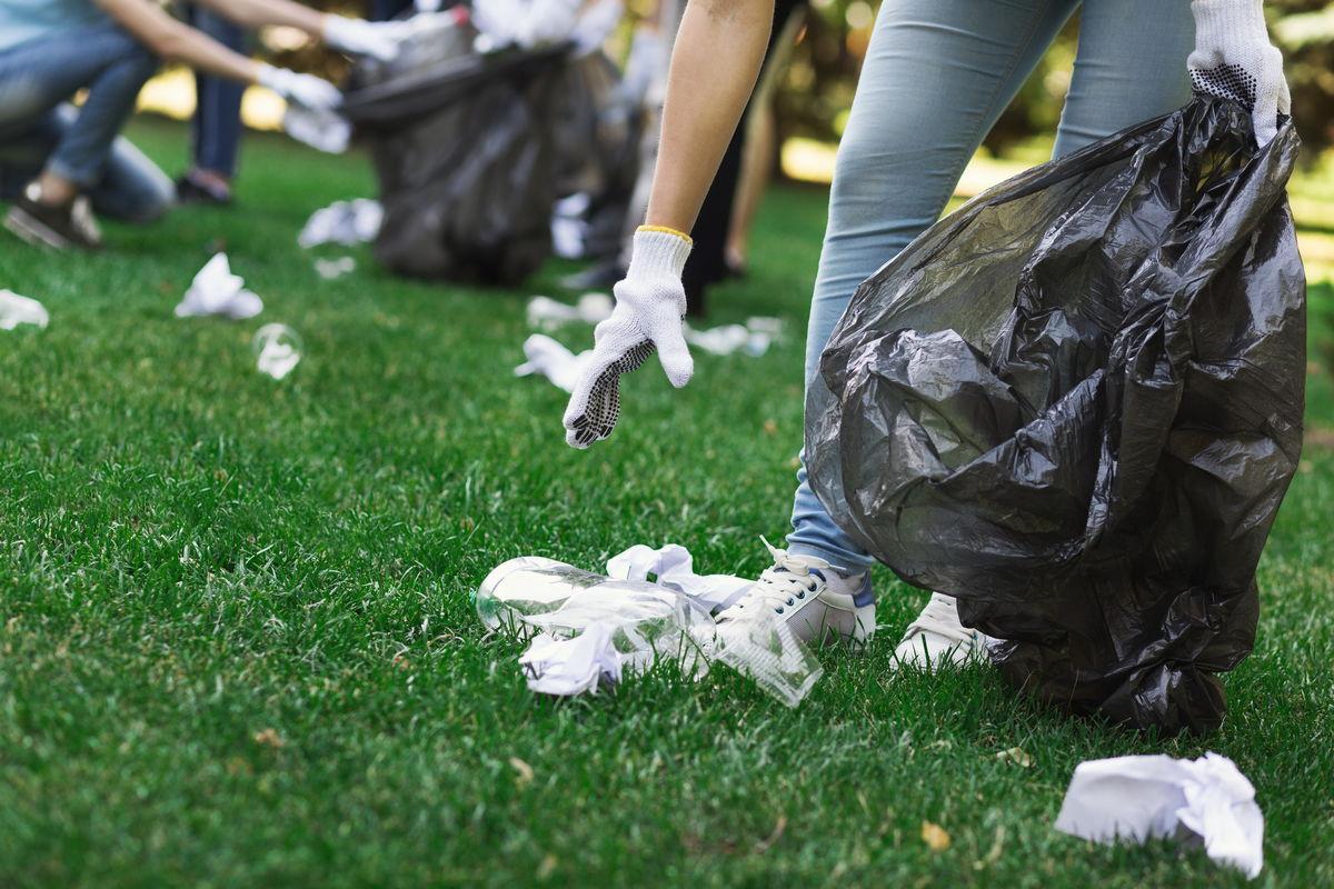 trash hauling Trash Hauling Benefits young volunteers collecting garbage in suumer C5BDALW