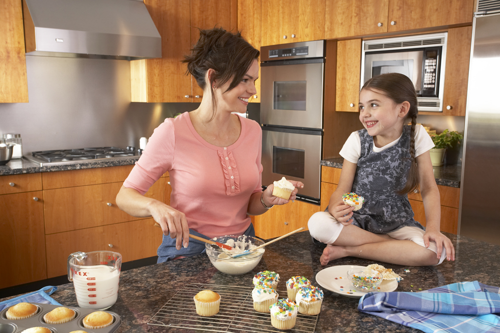 All The HVAC Advice You Need To Know To Save Money This Summer-Mother & daughter making cupcakes in the kitchen