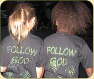 Two girl wearing Follow God shirts
