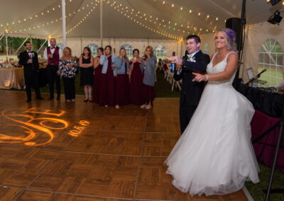 Bride and Groom in front of DJ