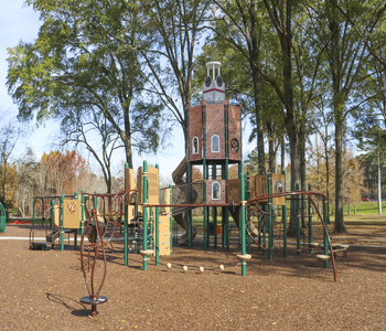 Outdoor playground with a red tower