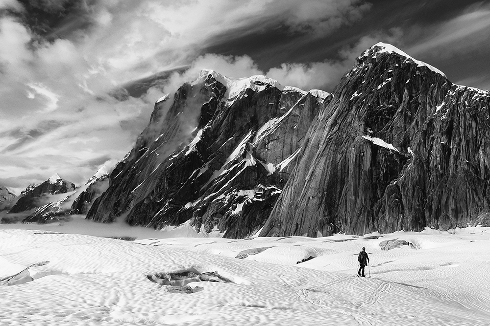 Mike Pond navigates the Ruth glacier with Mt. Dickey, Mt. Bradley, et al beyond. Ruth Gorge, AK