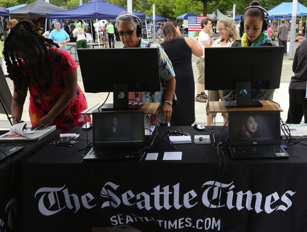 """The Seattle Times """"Under Our Skin"""" interactive booth at BAAMFest at the Rainier Beach Community Center on Saturday, July 23, 2016 LO"""