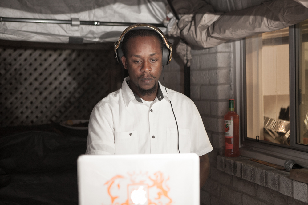 DJ Skin playing music on his laptop