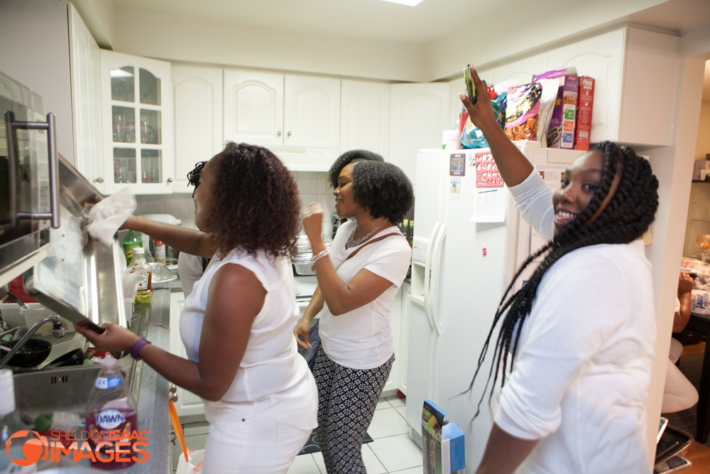 Ladies dancing in the kitchen at the BBQ Party