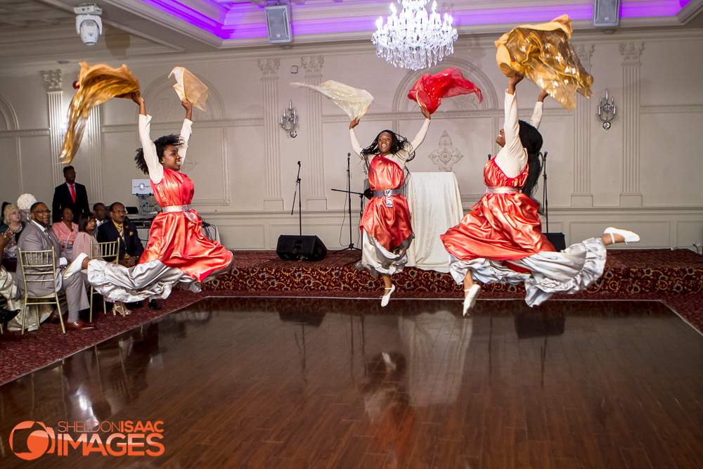 Ladies jump while performing a dance