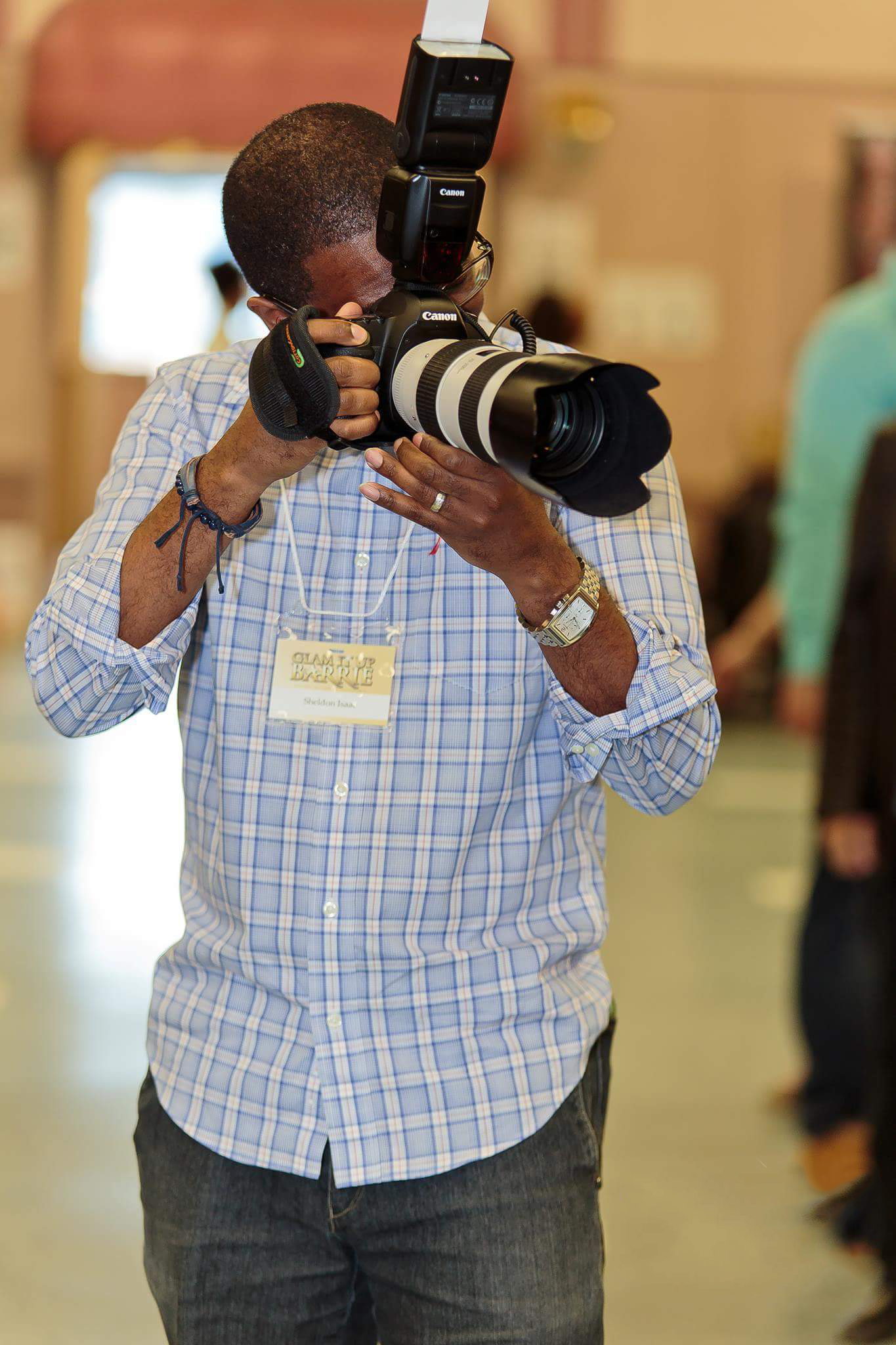 Sheldon Isaac shooting portraits at the Glam It Up Charity event in Barrie