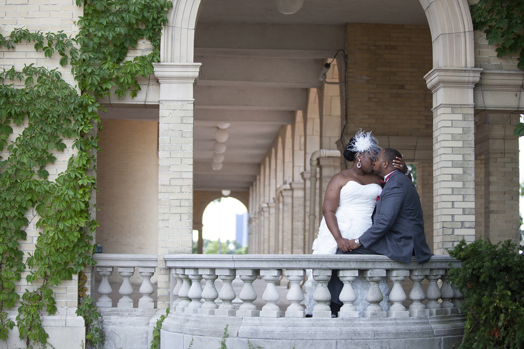 Bride and Groom kiss in Detroit photographed by Ajax Wedding Photographer Sheldon Isaac Images