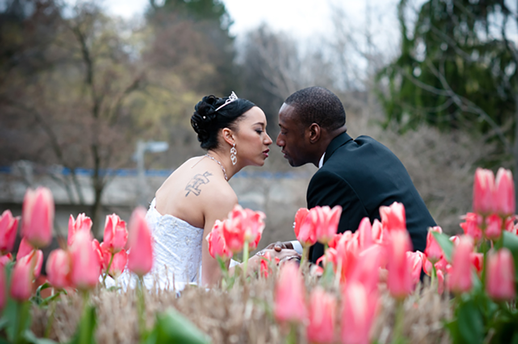 Bride and Groom at a park with flowers
