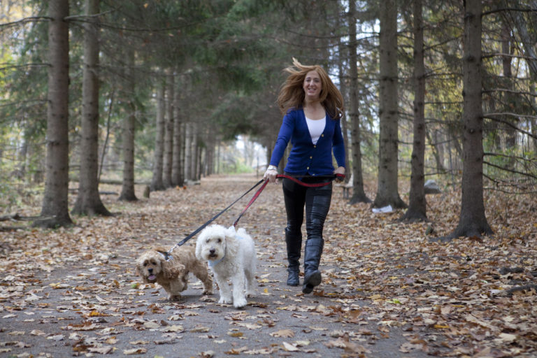 Portrait of lady walking her dogs at Sheppard's Bush Park in Aurora