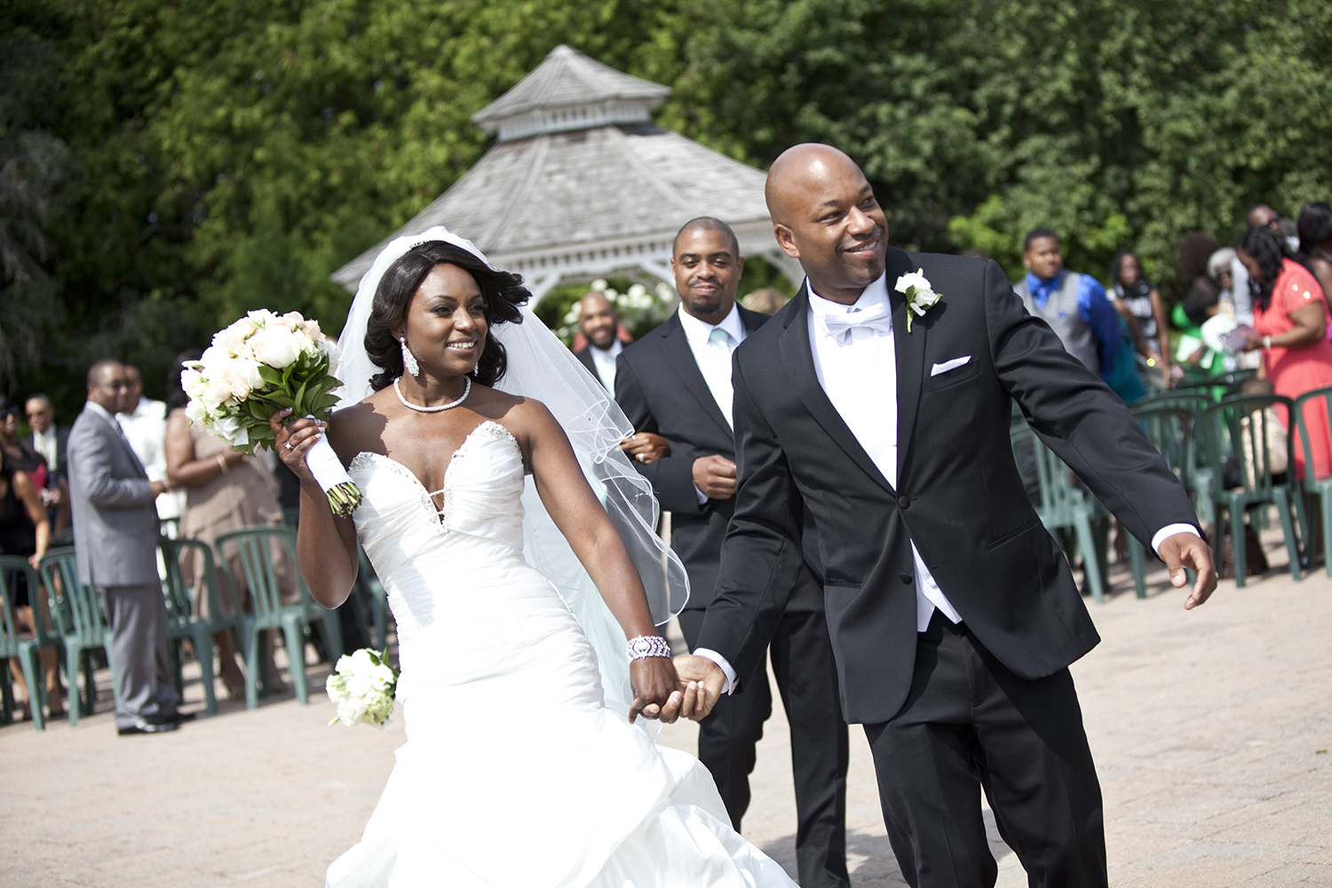 Bride and Groom leave the wedding ceremony at Deer Creek Golf and Banquet Facility in Ajax