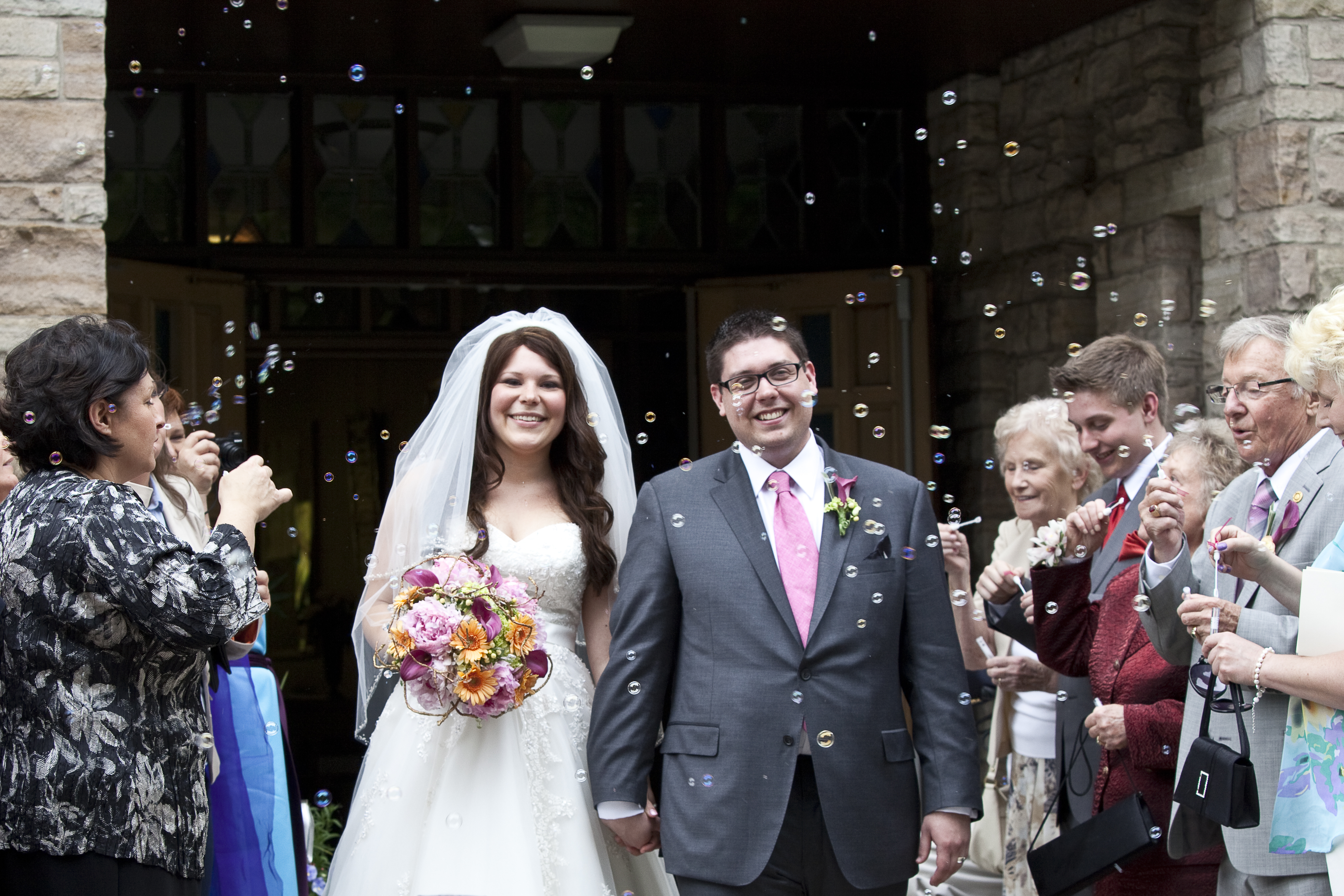 Bride and Groom leave church after their wedding ceremony in Hamilton Ontario