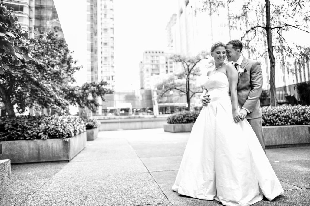 The Bride and Groom smile during the Bridal Party shoot in the Distillery District in Toronto