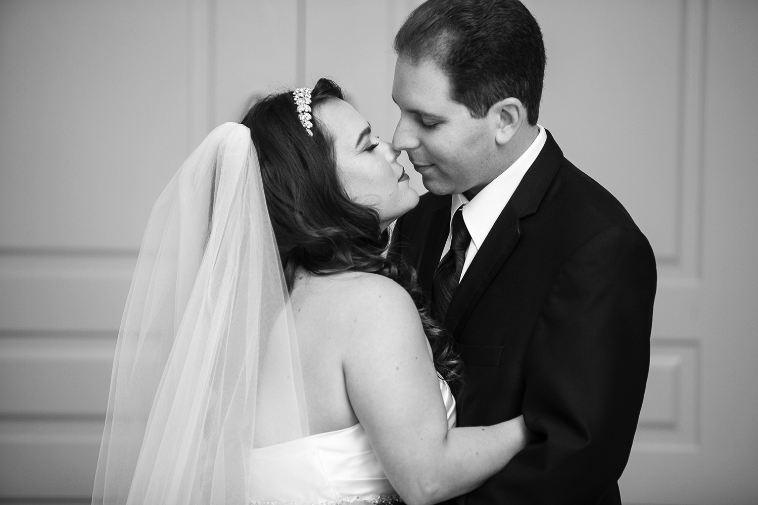 Bride and Groom kiss after their wedding ceremony at the Venetian in Vaughan