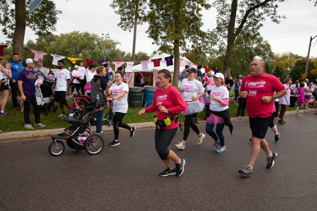 Lady pushing a stroller in the CIBC Run for the Cure in Oshawa