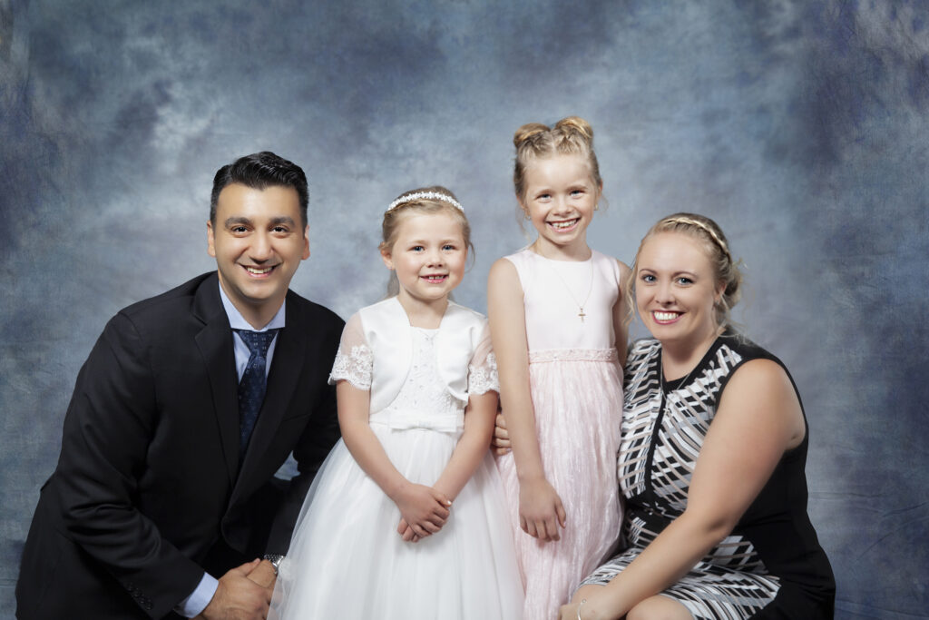 Family portraits with a smiling family in Uxbridge