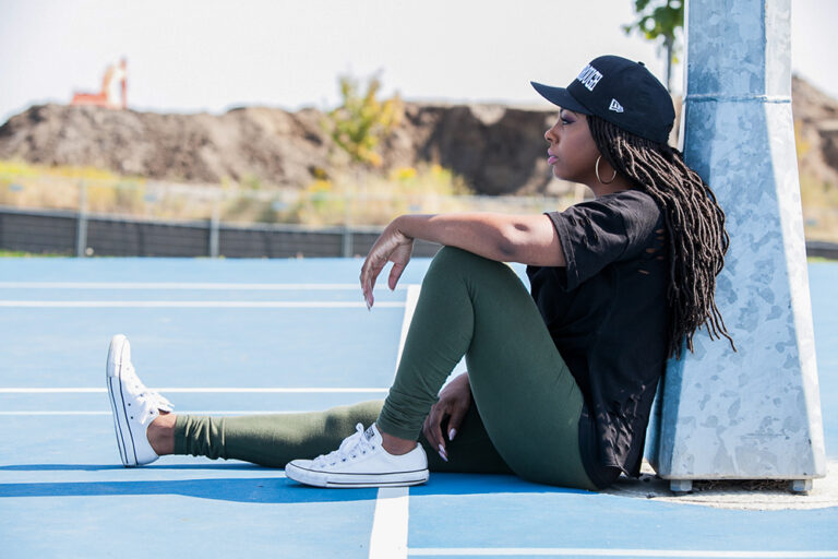 Lady sitting on the Audley Rec Centre basketball court