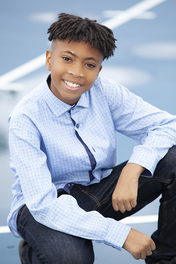 Young actor smiling at his photoshoot at Audley Recreation Centre in Ajax