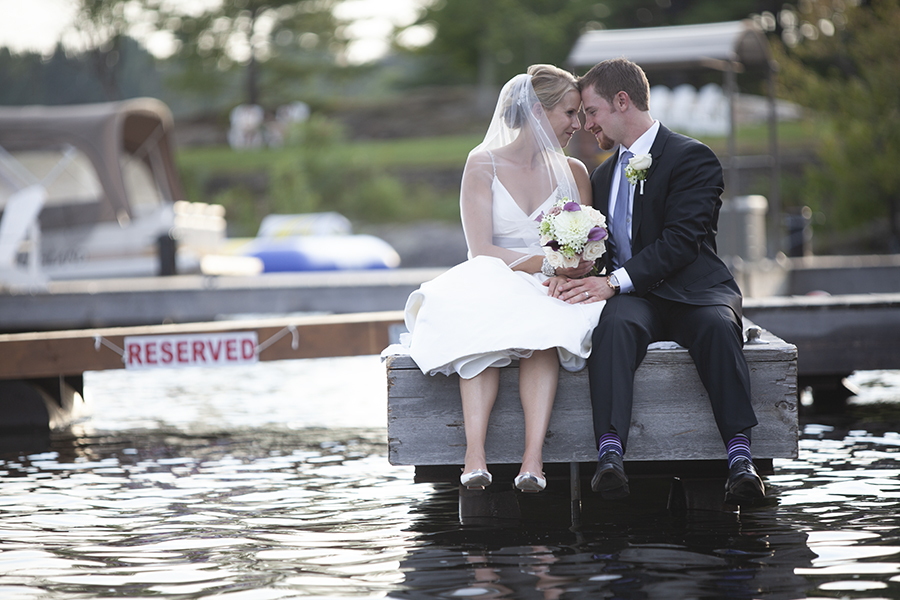 Bride and Groom sitting near the water