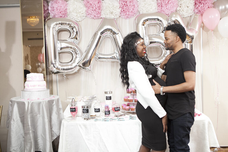 Scarborough baby shower couple smiling with each other