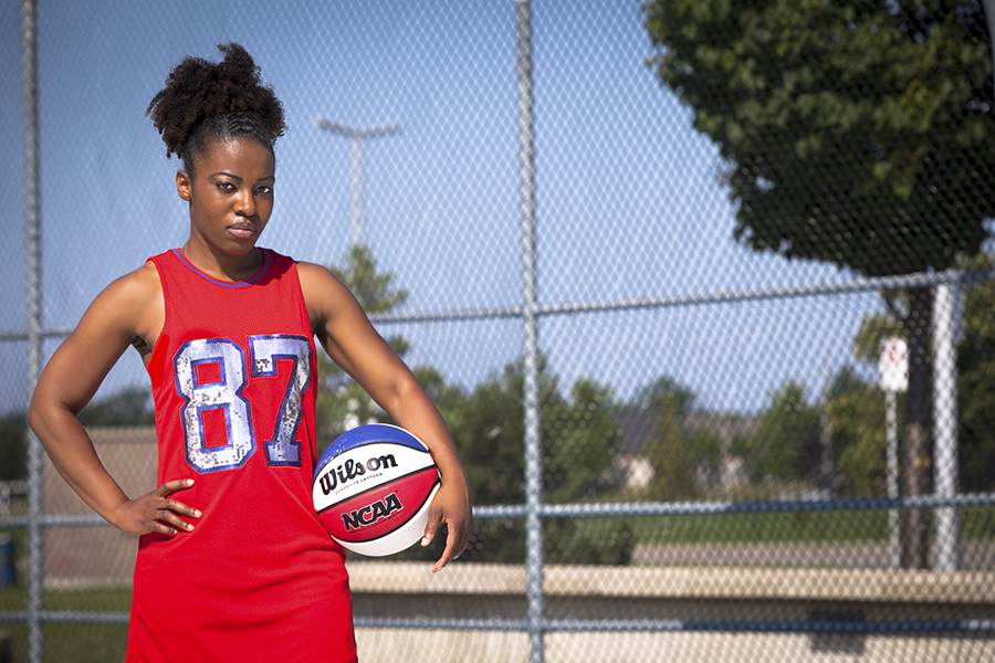 Athlete posing with a basketball for lifestyle photoshoot in Whitby
