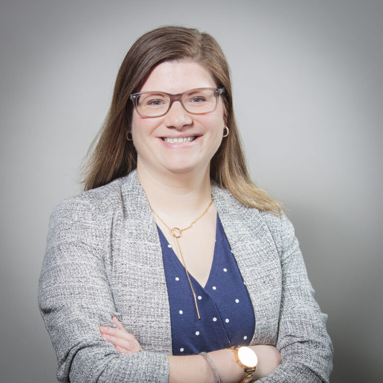 Female executive smiling at camera in Ajax for her corporate headshot