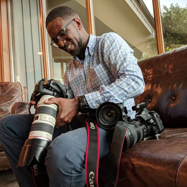 Photographer Sheldon Isaac with his cameras in Whitby