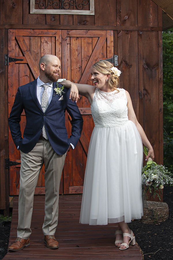 Groom and Bride look at each other at Millbrook Cathedral