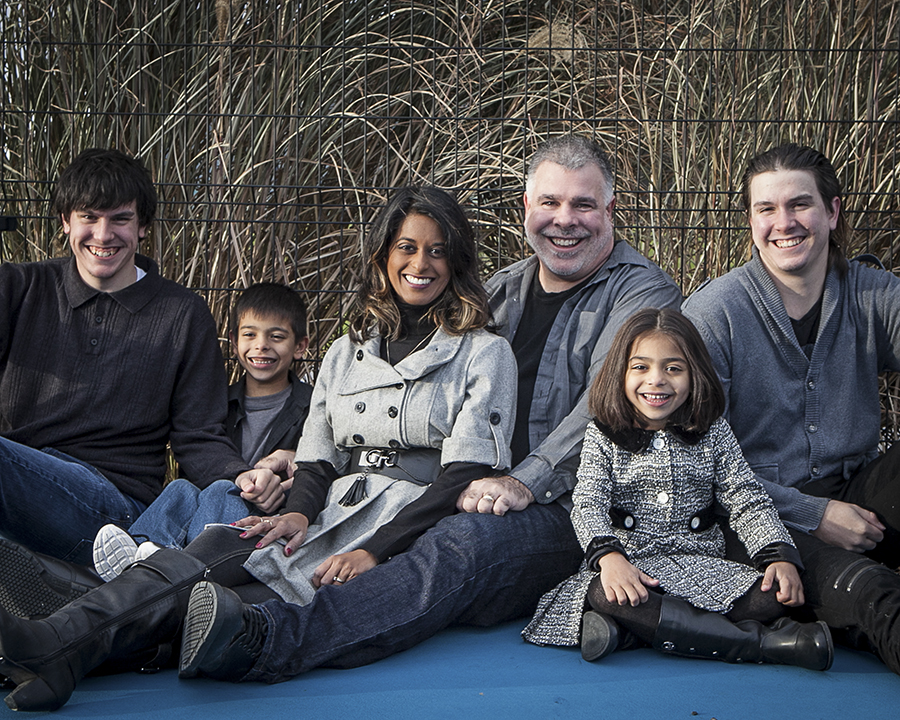 Family smiling at the Audley Recreation Centre in Ajax during their photoshoot