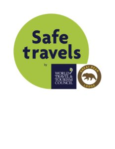 Safe Travels logo certifying Great Bear Lodge as a safe destination during COVID