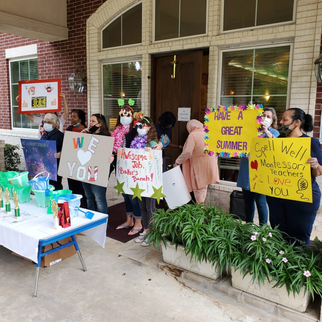 Teachers holding signs