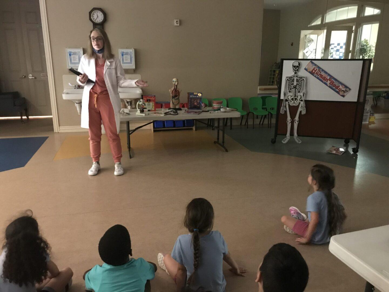 A nurse teaching children