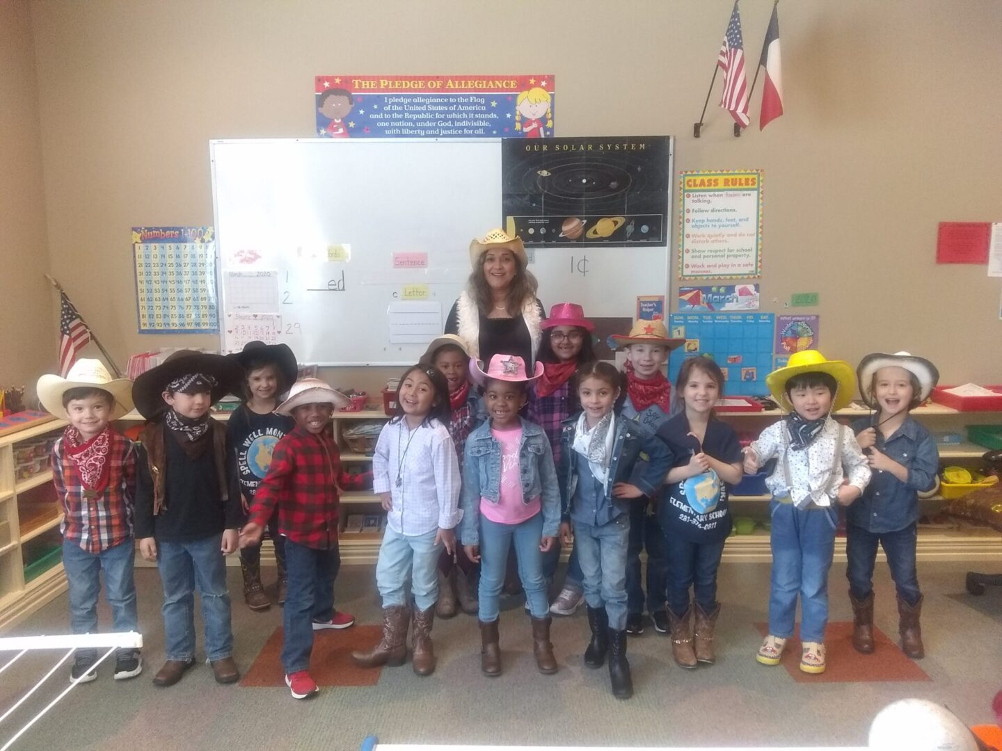 Children wearing cowboy outfits
