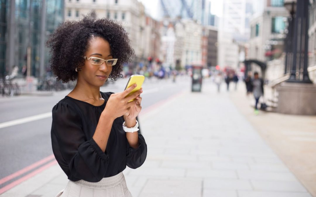 A woman sending free text while traveling abroad.